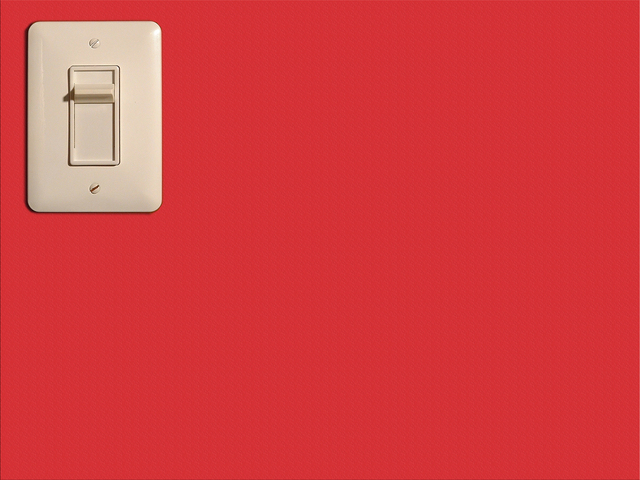 vypínač na červené zdi